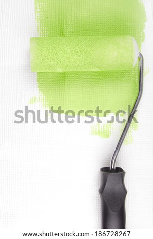 paint roller decorating wall