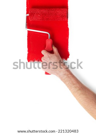 Paint roller Hand with paint roller isolated on white