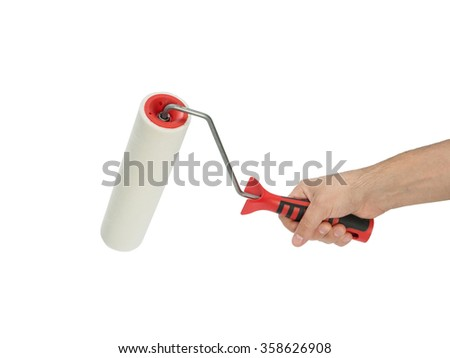 Paint roller in man's hand isolated on white background - stock photo