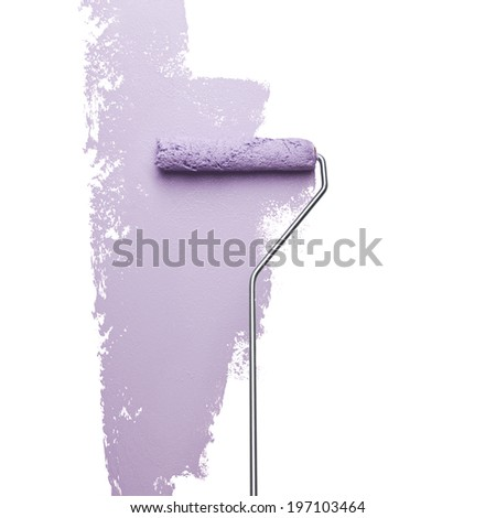 Paint roller on white wall, studio shot - stock photo