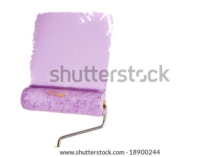 Paint roller painting the wall. - stock photo