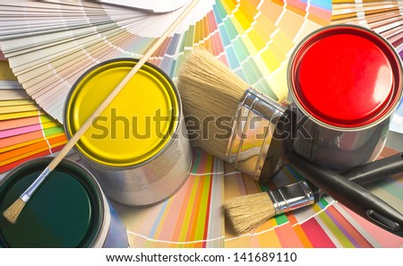 Paint samples. Sample of colorful paint. Cans of red, yellow and green paint.