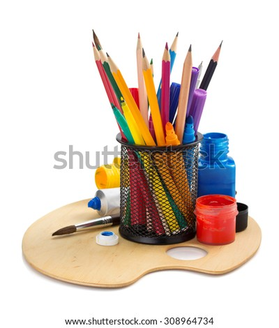 paint supplies and holder basket on white background - stock photo
