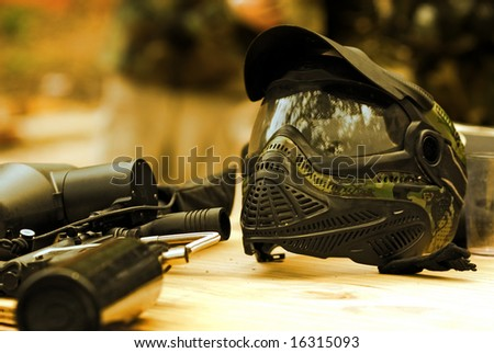 Paintball mask and marker - stock photo