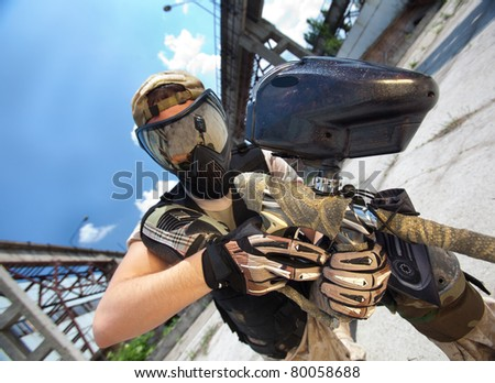 Paintball player, close up outdoor shot - stock photo