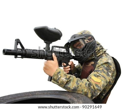 Paintball player isolated on white - stock photo