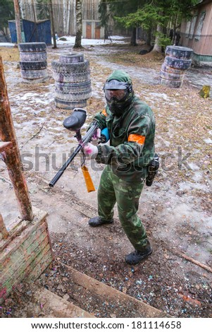 Paintball player while game - stock photo