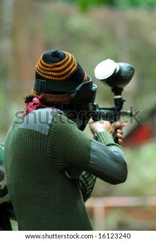 Paintball shooting - stock photo