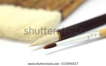 paintbrush and asian writing brush isolated on white background