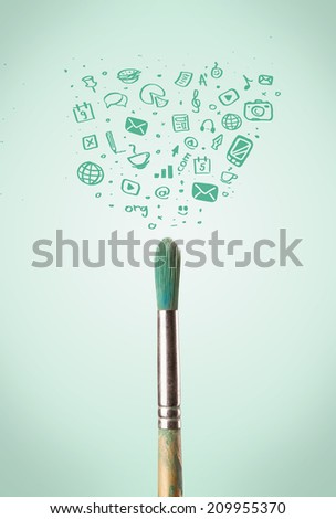 Paintbrush close-up with sketchy social media icons - stock photo