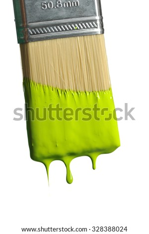 Paintbrush dripping green paint isolated over white background - stock photo