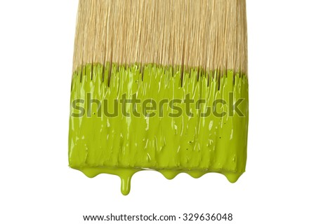 Paintbrush dripping green paint isolated over white background
