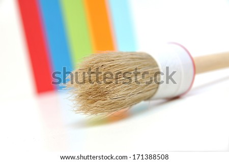 Paintbrush in front of color scheme - stock photo