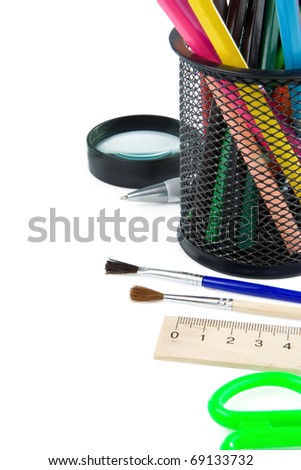 paintbrush, magnifier and pencils in holder isolated on white background - stock photo