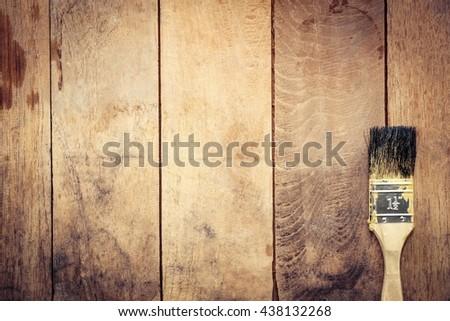 Paintbrush on old wood - stock photo
