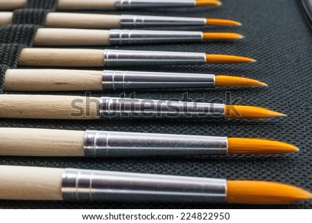 Paintbrush set, different size round brushes with easy-to-clean polyester bristles - stock photo
