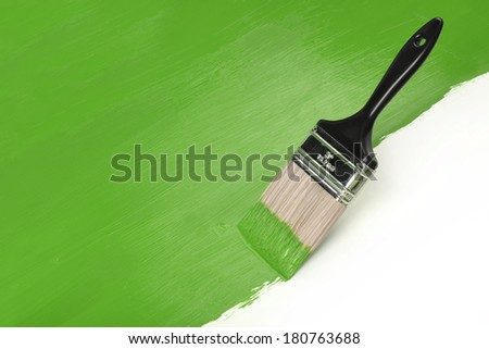 Paintbrush with green paint with Copy Space - stock photo