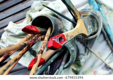 Paintbrushes, full with colors, painting cloth