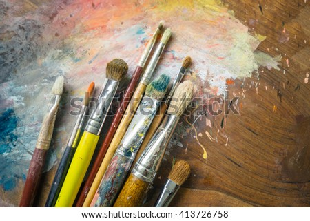 Paintbrushes on a palette - stock photo