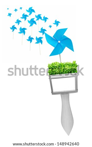 paintbrushes painting beautiful wind turbines. Ecological power concept - stock photo