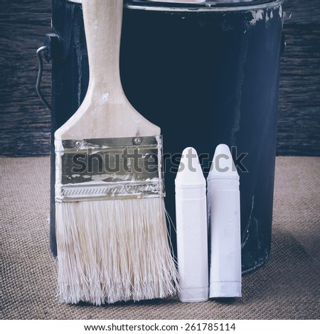 Paintbrushes with DIY Chalkpaint Conceptual - stock photo