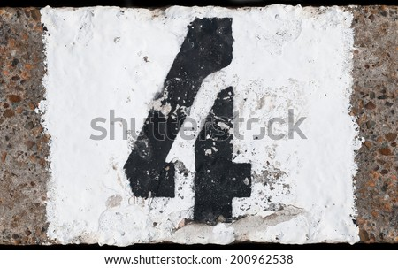 Painted abstract black number on painted white concrete background - stock photo