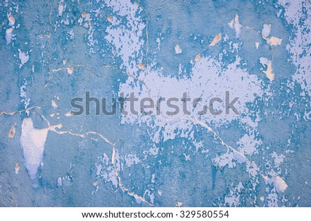 Painted blue old stone wall - stock photo