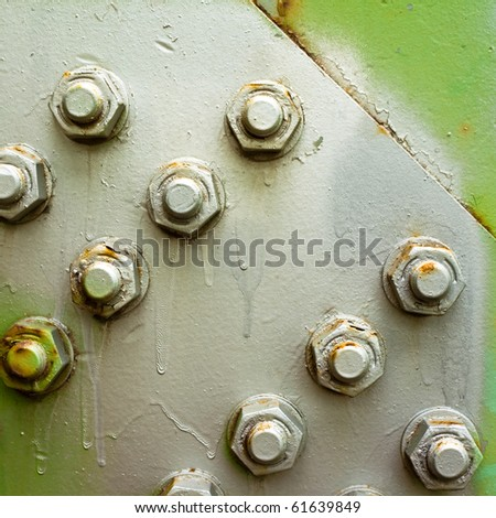 Painted bolts of steel structure (bridge) make abstract background texture - stock photo