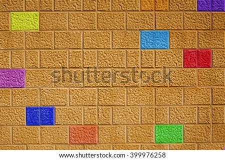 Painted brick wall background with different colored bricks, abstract pattern, colorful, fun design.