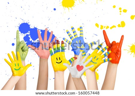 painted children's hands in different colors with smilies - stock photo