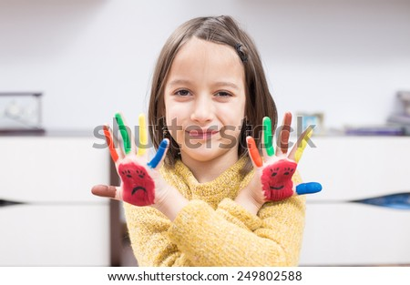 Painted colored hand, smile girl - stock photo