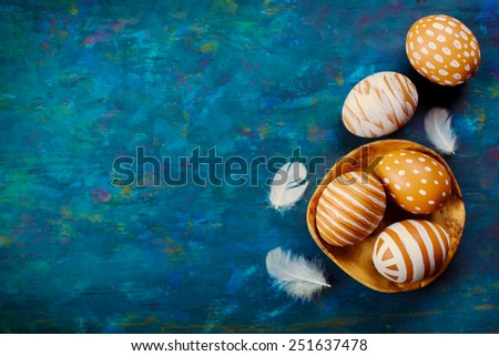 Painted colorful easter eggs on a blue background - stock photo