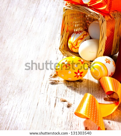 Painted Colorful Easter Eggs on texture old white background/ vintage card with easter eggs in basket with bow - stock photo