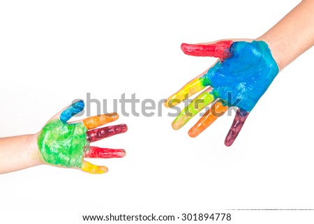 Painted colorful hands of kid on white background - stock photo