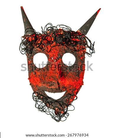 Painted devil face mask isolated over white - stock photo