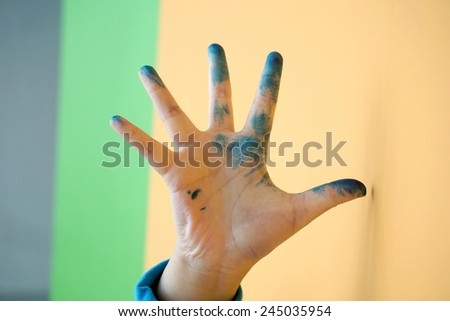 painted dirty kid's hand - stock photo