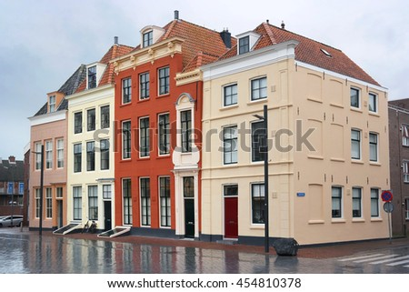 Painted Dutch Homes in Vlissingen, a city in the province of Zeeland in southwestern Netherlands. - stock photo