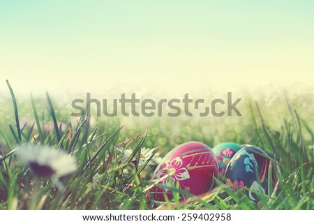painted easter eggs in the field - stock photo