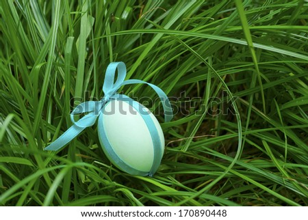 painted easter eggs in the grass - stock photo
