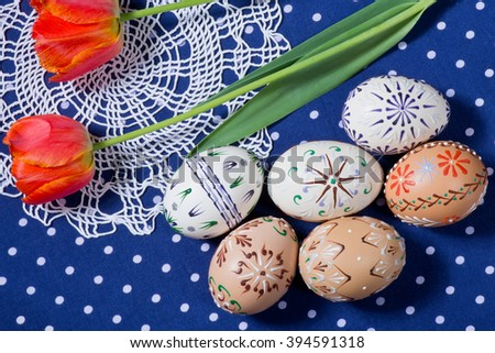 Painted Easter eggs on the blue tablecloth