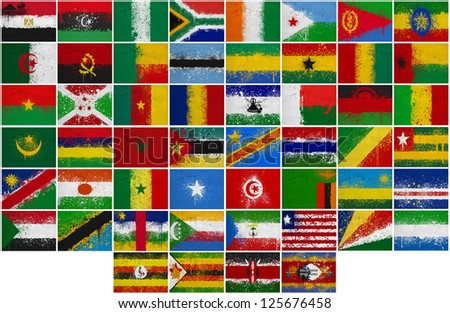 Painted Flags of Africa at the cracked wall - stock photo