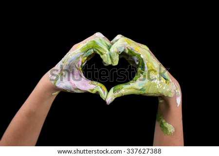 Painted hands make a heart shape.  Love Shape Hand.