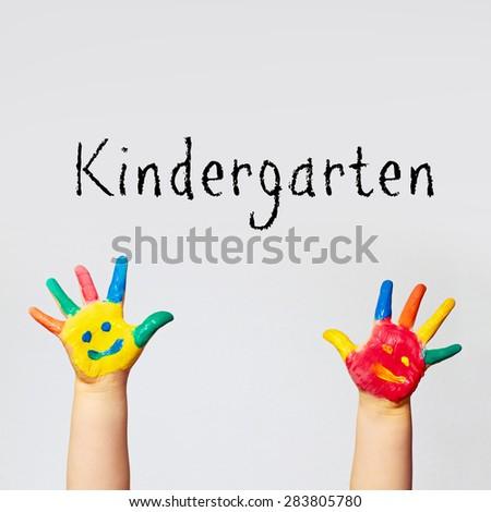 painted hands of little child - kindergarten - stock photo