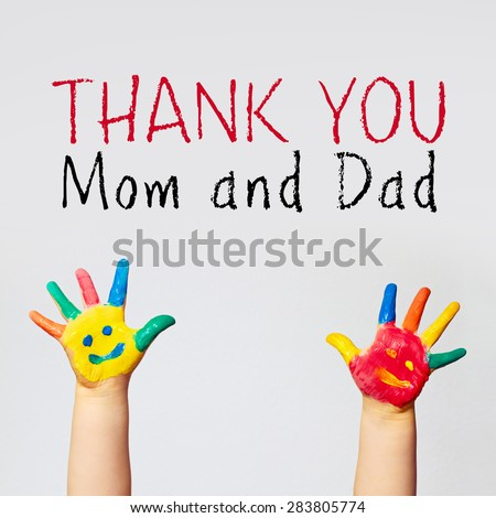 painted hands of little child - thank you mom and dad - stock photo