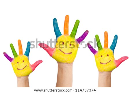 Painted in different colors, with the palms painted smiling faces, a few childs hands raised up. Greeting or voting approval or teamwork. Isolated on white background - stock photo