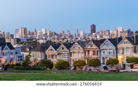 Painted Ladies houses and Downtown background from Alamo Square