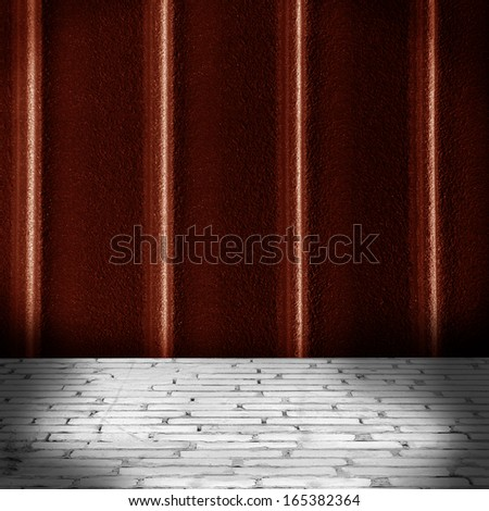 painted metal wall and brick floor interior - stock photo