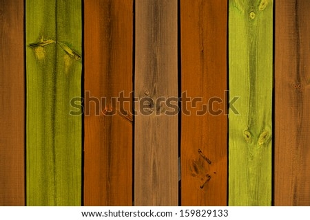 Painted multicolored wooden planks as a background