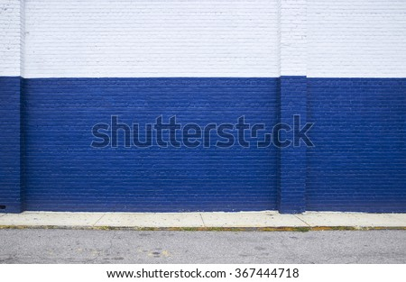 Painted on blue brick wall on the street - stock photo