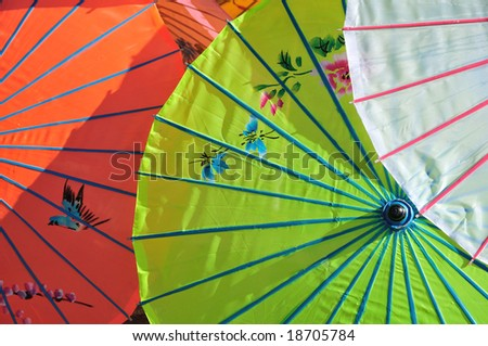 painted parasols in an outdoor market